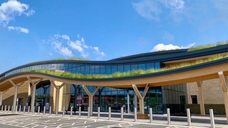 Innovative wildflower living roof design helps new motorway services blend in with the surrounding landscape